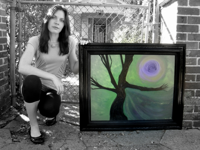Artist Rachael Harbert holds abstract landscape painting of a black tree and purple swirling background with a dark moon entitled Purple Shadows