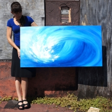 Artist Rachael Harbert holding reverse auction painting Crashing Wave