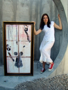 "Artist Rachael Harbert with painting ""Against a Window"""