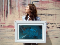 "Artist Rachael Harbert with painting ""Alogo"""