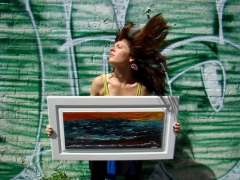 "Artist Rachael Harbert with painting ""Angry Sea"""