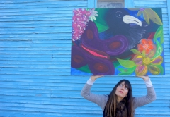 "Artist Rachael Harbert with painting ""Blue Bird of Paradise"""