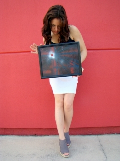"Artist Rachael Harbert with painting ""Bullet Hole"""