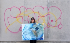 "Artist Rachael Harbert with painting ""Dance on Ice"""