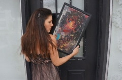 "Artist Rachael Harbert with painting ""Ebony"""