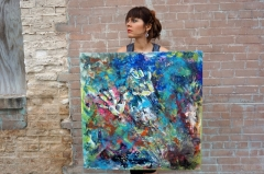 "Artist Rachael Harbert with painting ""Electromagnetic"""