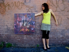 "Artist Rachael Harbert with painting ""Enclosed"""