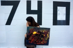 "Artist Rachael Harbert with painting ""Fire Within"""