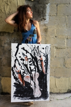 "Artist Rachael Harbert with painting ""Fireproof"""