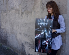 "Artist Rachael Harbert with painting ""Flashlights"""