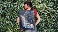 "Artist Rachael Harbert with painting ""Forlorn"""