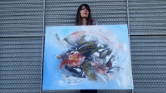 "Artist Rachael Harbert with painting ""Inception"""