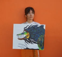"Artist Rachael Harbert with painting ""Joka"""
