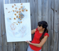 "Artist Rachael Harbert with painting ""Playing with Leaves"""