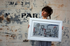 "Artist Rachael Harbert with painting ""Robots"""