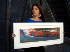 "Artist Rachael Harbert with painting ""Sky on Fire"""