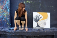 "Artist Rachael Harbert with painting ""Spun Gold"""