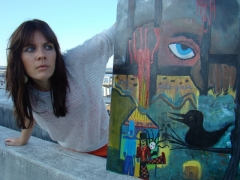 "Artist Rachael Harbert with painting ""Strange Boxes"""