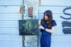 "Artist Rachael Harbert with painting ""Stranger in the Alley"""