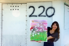 "Artist Rachael Harbert with painting ""Wild Periwinkles"""