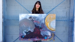 "Artist Rachael Harbert with painting ""Yearning for Light"""