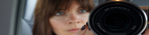Closeup of Artist Rachael Harbert holding a camera