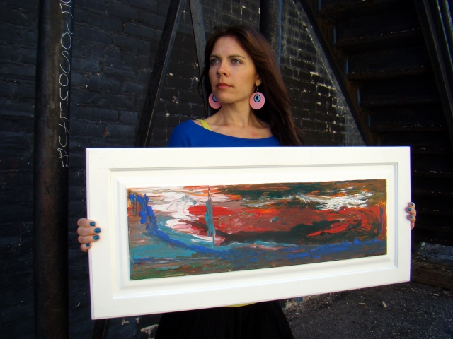 Artist Rachael Harbert holds abstract landscape painting of a red and blue sky entitled Sky on Fire in front of black building