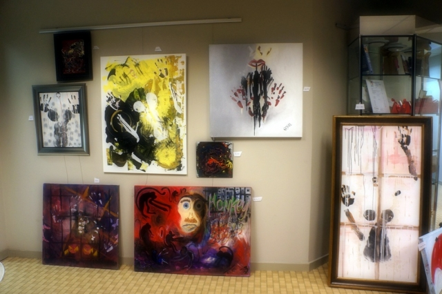 A display of 8 of Rachael Harbert's paintings at an art show