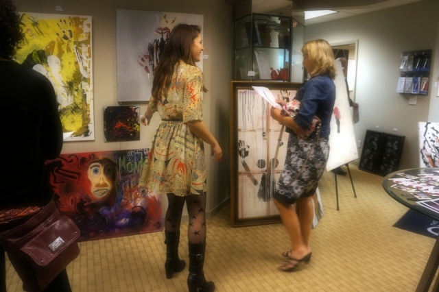 Artist Rachael Harbert talks with Pam Brodsack at one of her art shows