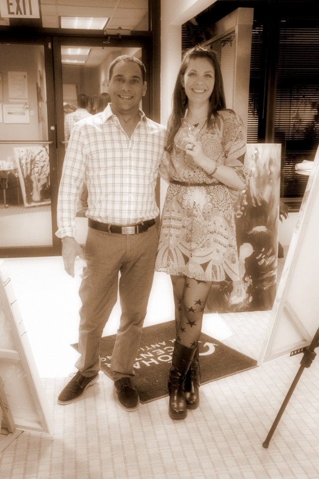 Artist Rachael Harbert poses with client Jonathan Belloit at one of her art shows