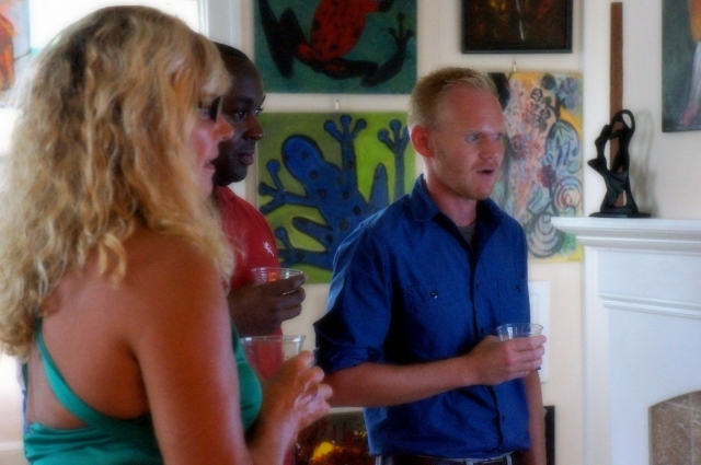 Kenny Higginbotham shows amazement at one of Rachael Harbert's paintings