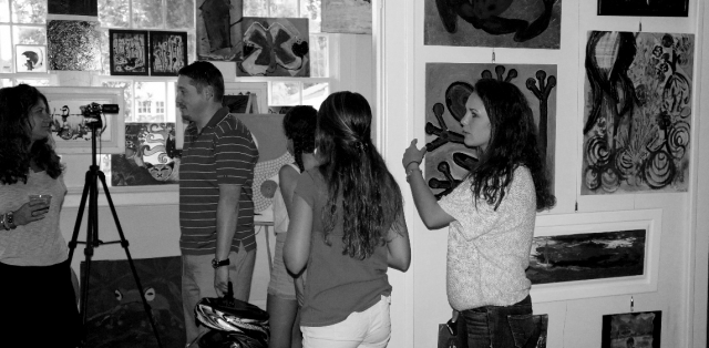 A small group of teenagers arrive to see Rachael's work in her in-home art studio