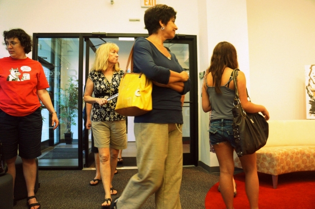 A picture of people entering Rachael Harbert's art show hosted by the Perdue company