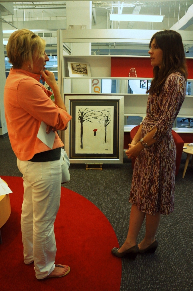 Artist Rachael Harbert talks with a lady from the Jacksonville Chamber of Commerce