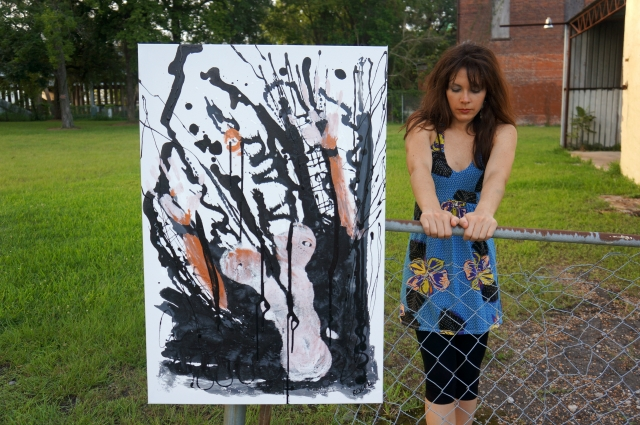 "Artist Rachael Harbert holding on to a fence next to abstract expressionism painting ""Fireproof"""