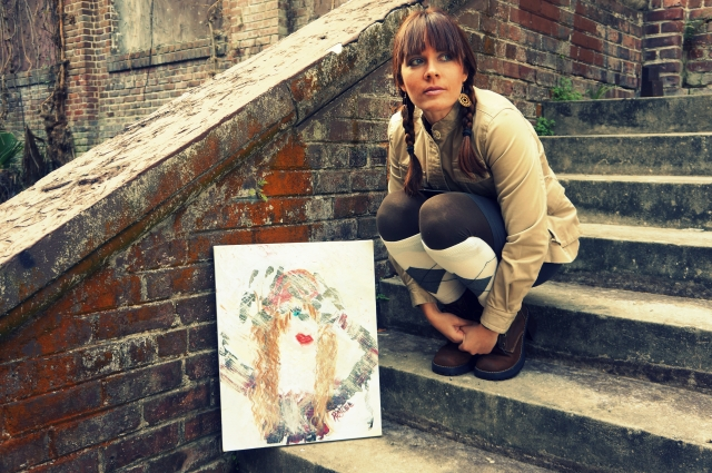 "Artist Rachael Harbert crouches next to abstract painting ""Bundled"" as it sits on steps"