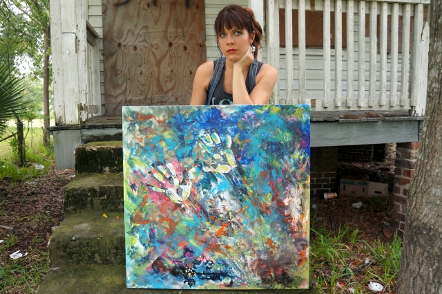 "Artist Rachael Harbert sitting on the porch of a house with abstract expressionism painting ""Electromagnetic"""
