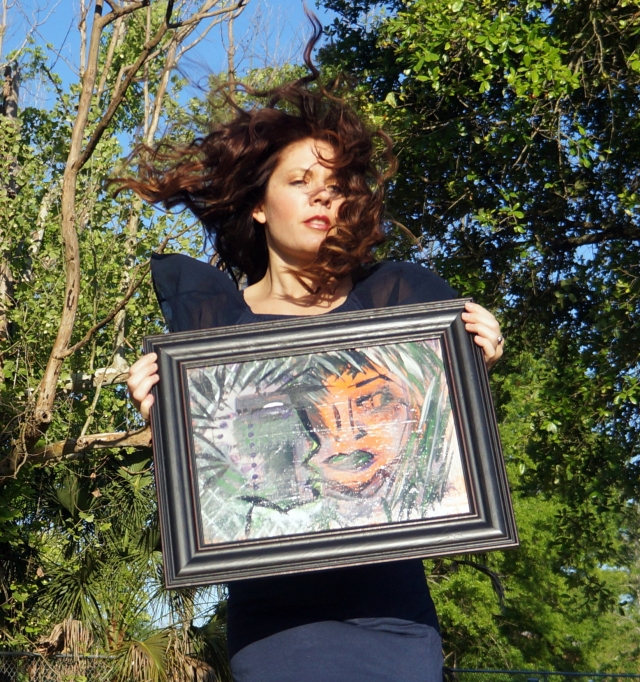 "Artist Rachael Harbert holding abstract expressionism painting ""Fearless"" as she jumps"