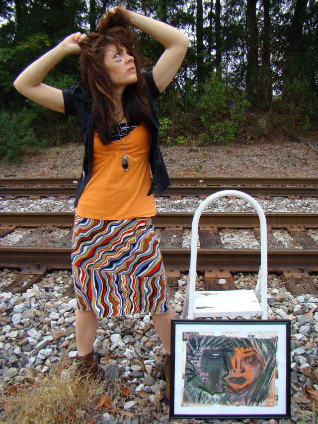 "Artist Rachael Harbert standing next to abstract expressionism painting ""Fearless"" in front of train tracks"