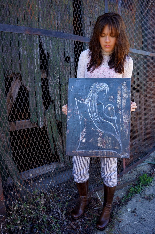 "Artist Rachael Harbert holds original version of painting ""Forlorn"""