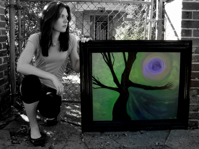 "Artist Rachael Harbert kneels next to abstract expressionism painting ""Purple Shadows"""