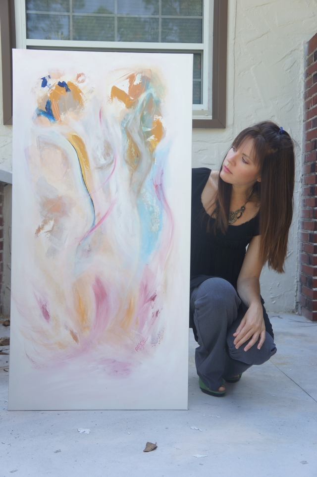 "Artist Rachael Harbert props up abstract expressionism painting ""Sleepwalking"" as she crouches on cement steps"
