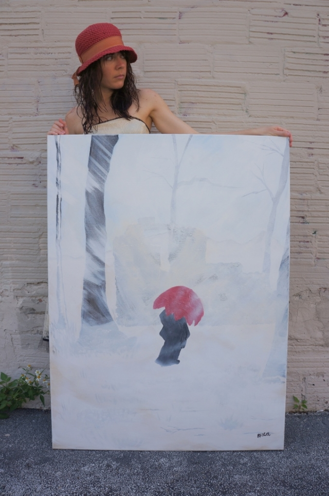 "Artist Rachael Harbert wearing a red hat standing in front of a block wall with painting ""White Storm"""