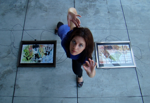 """Artist Rachael Harbert hovers over abstract expressionism painting """"Retro Girl"""""""