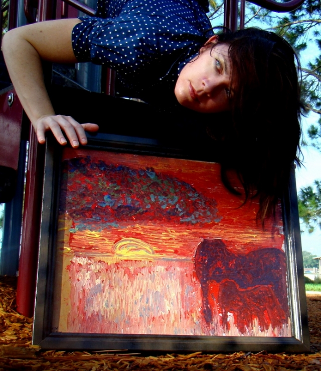 "Artist Rachael Harbert hanging upside down on a playground with abstract painting entitled ""Asian Maataa"""