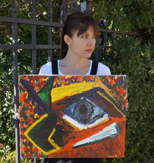 "Artist Rachael Harbert holds abstract painting ""Caged"""