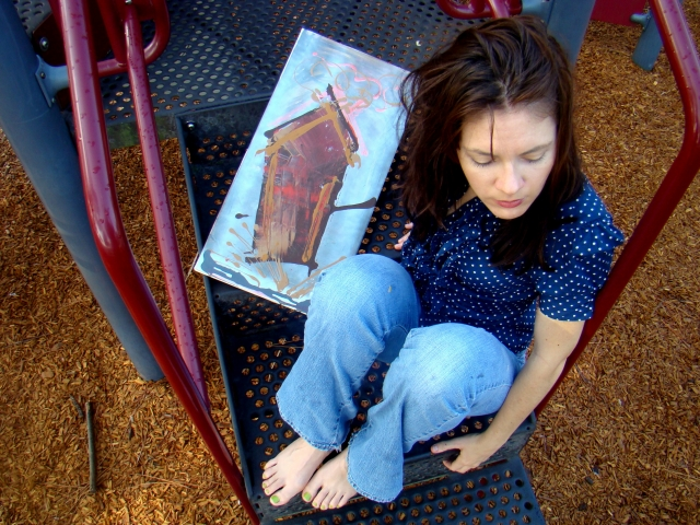 """Artist Rachael Harbert sitting on playground steps holding abstract painting """"Gingerbread"""""""