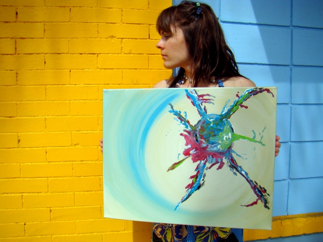 "Artist Rachael Harbert holds painting ""Spindle"" in front of a blue and yellow wall"