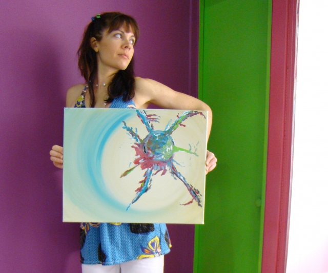 "Artist Rachael Harbert holds painting ""Spindle"" in front of purple, green and pink wall"