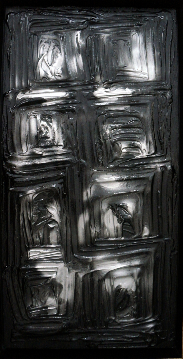 Abstract painting of black and white squares
